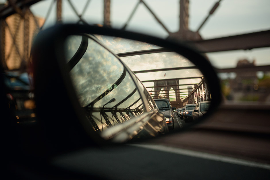 Brooklyn Bridge viewed through rearview mirror