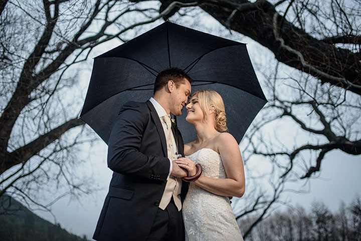 Winter Hanmer Springs Braemar Lodge wedding under black umbrella