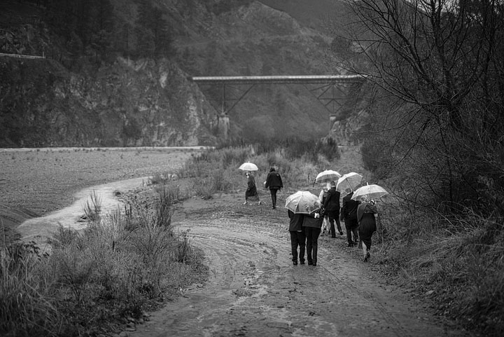 Bridal party photo down at the riverbed for a winter rainy wedding in Hanmer Springs