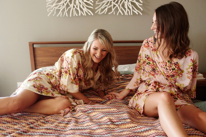 Bride and bridesmaid on bed