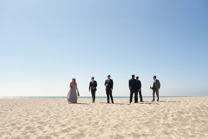 Groom and men on Oxnard beach