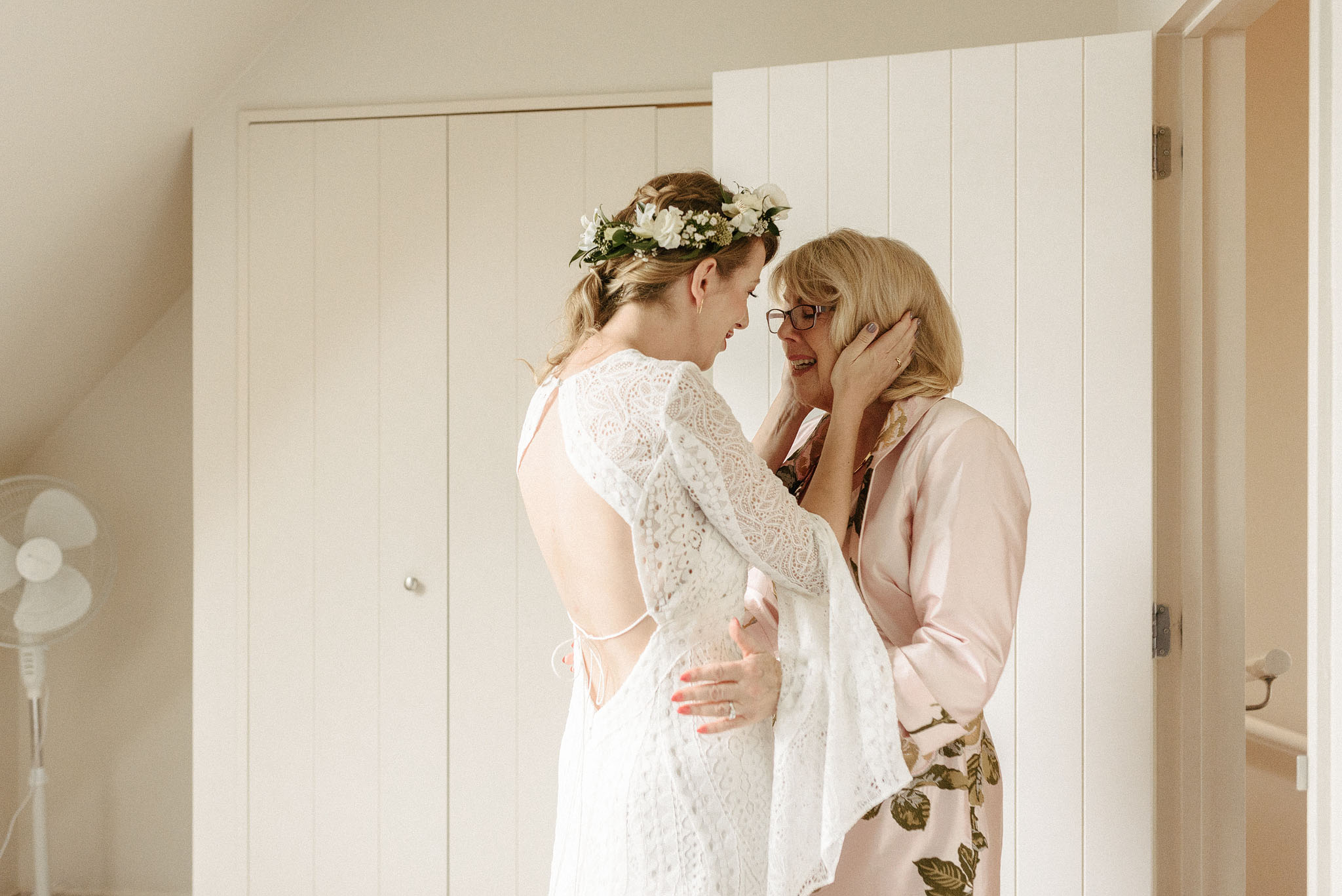 Mum and daughter on morning of daughter's wedding