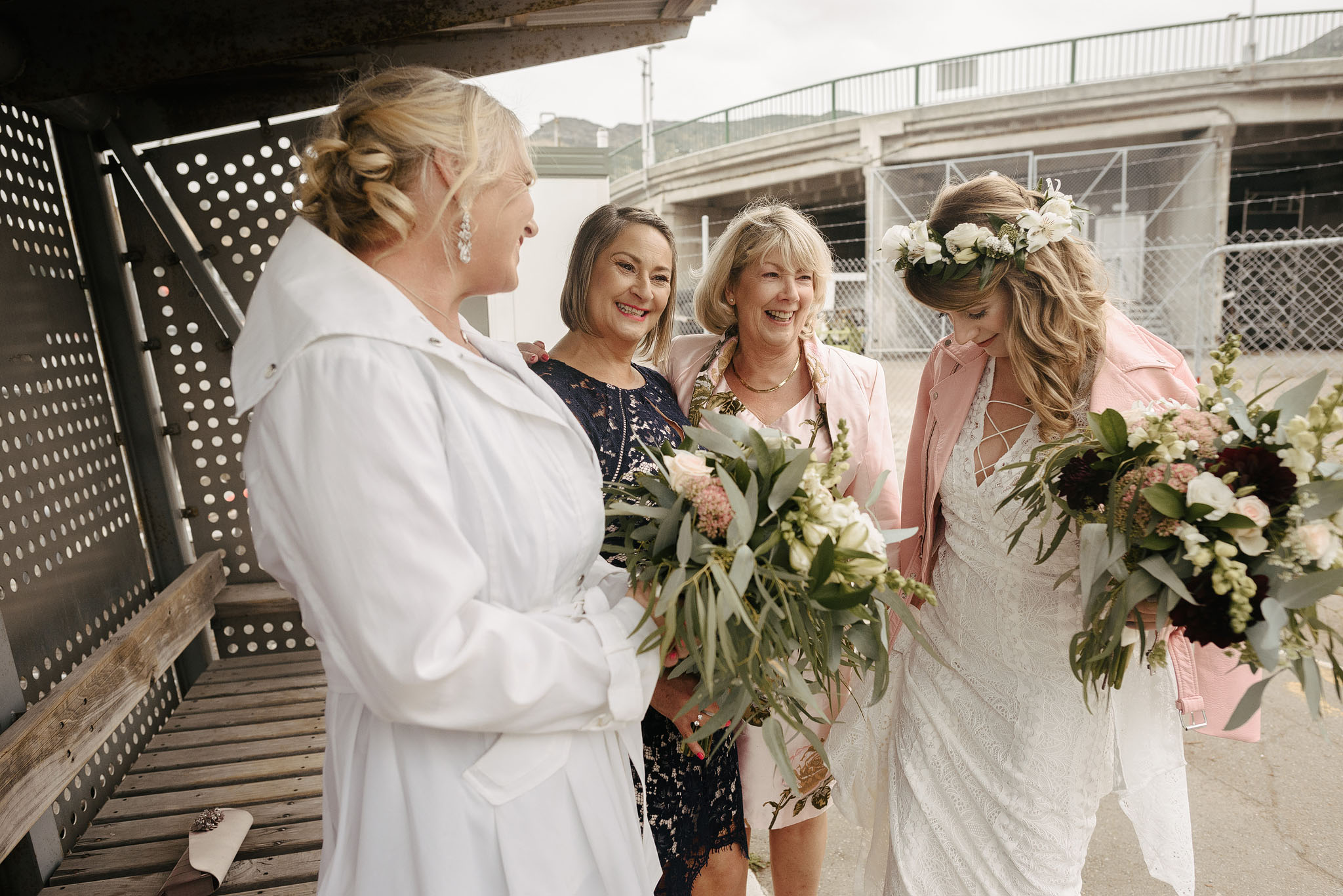 Bride and bridesmaids at Lyttelton waiting for Quail Island ferry