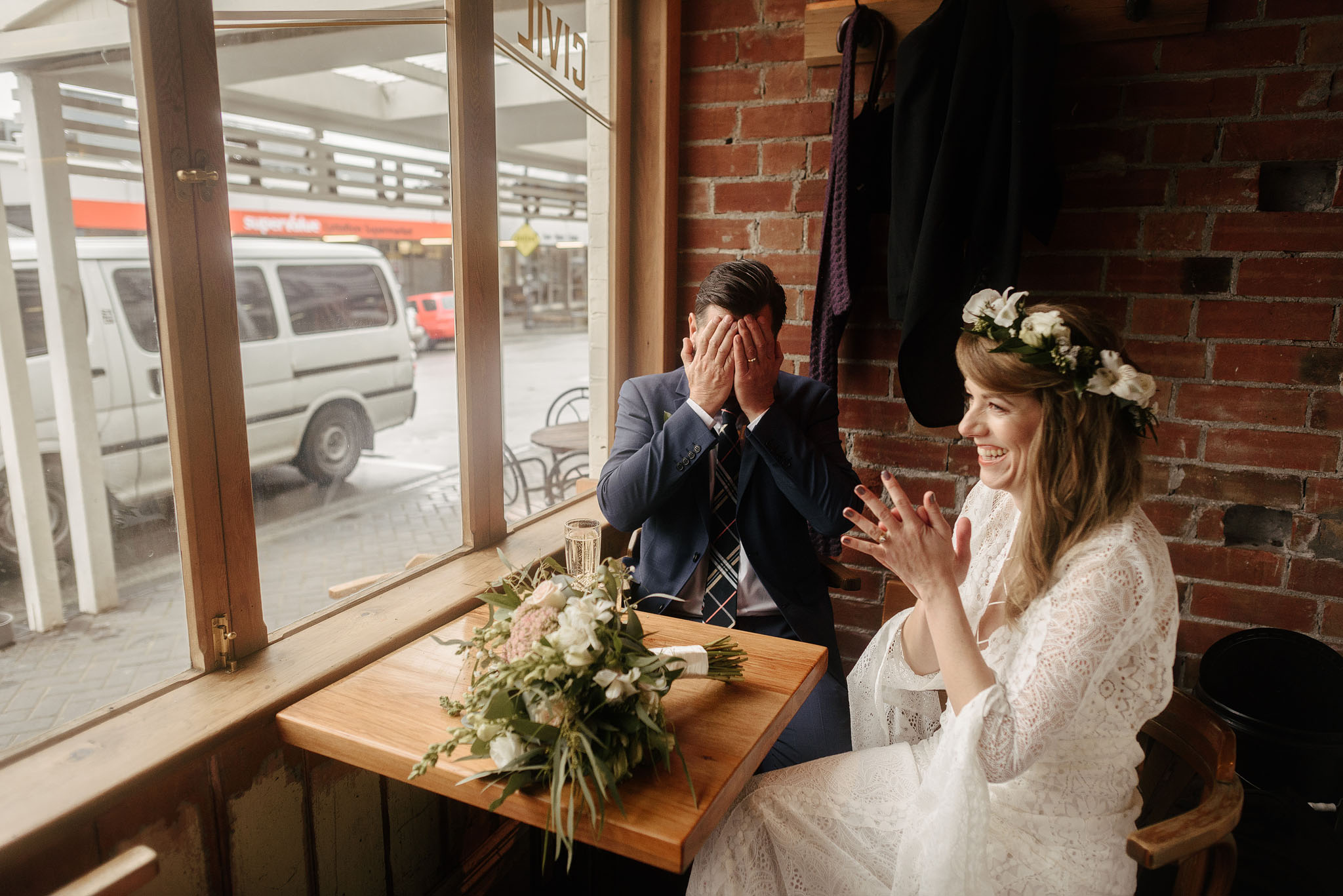 Couple laughing at Civil and Naval post wedding