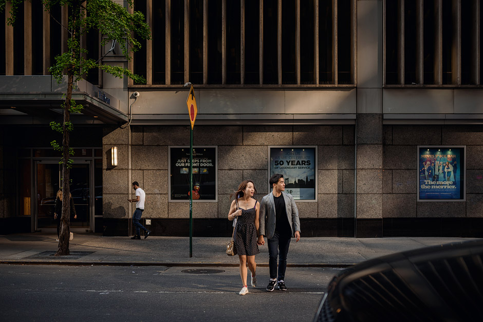 Crossing the street in New York City - post wedding portrait session of Clare and Josh