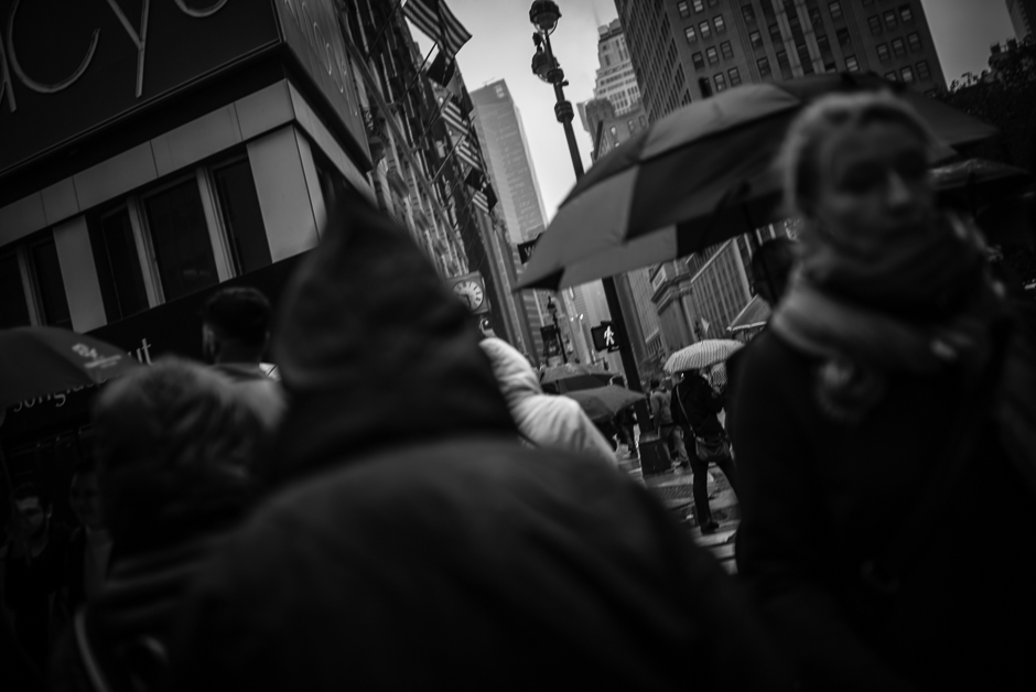 New York rainy day black and white photograph of people with umbrellas