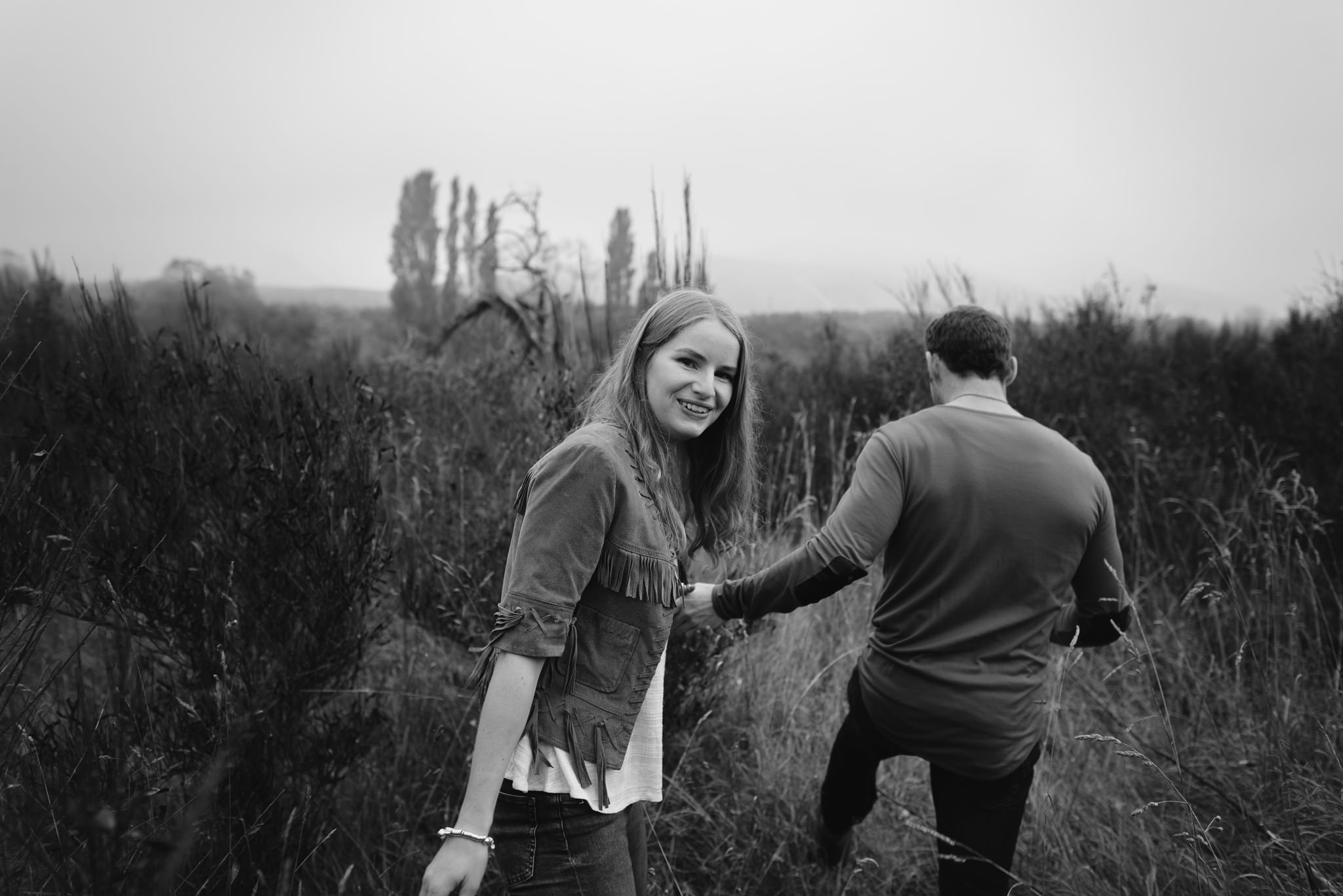 Black and white, couple holding hands during engagement shoot
