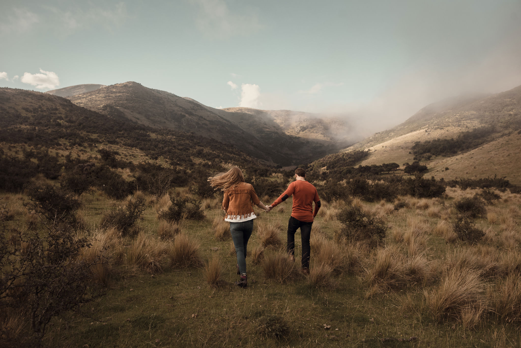 Couple heading into misty light - New Zealand engagement shoot in the mountains