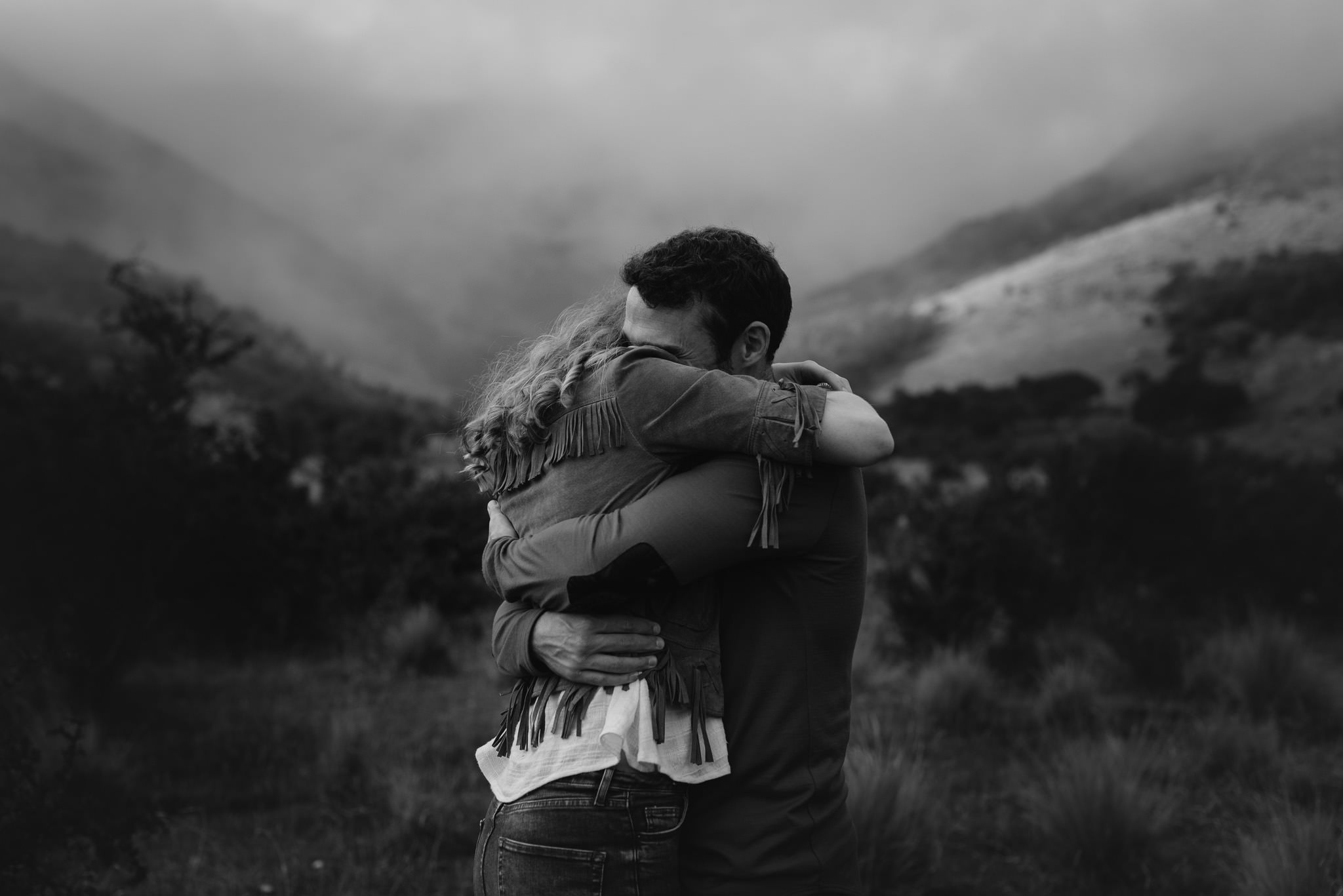 Black and white emotional hug - engagement shooting in New Zealand