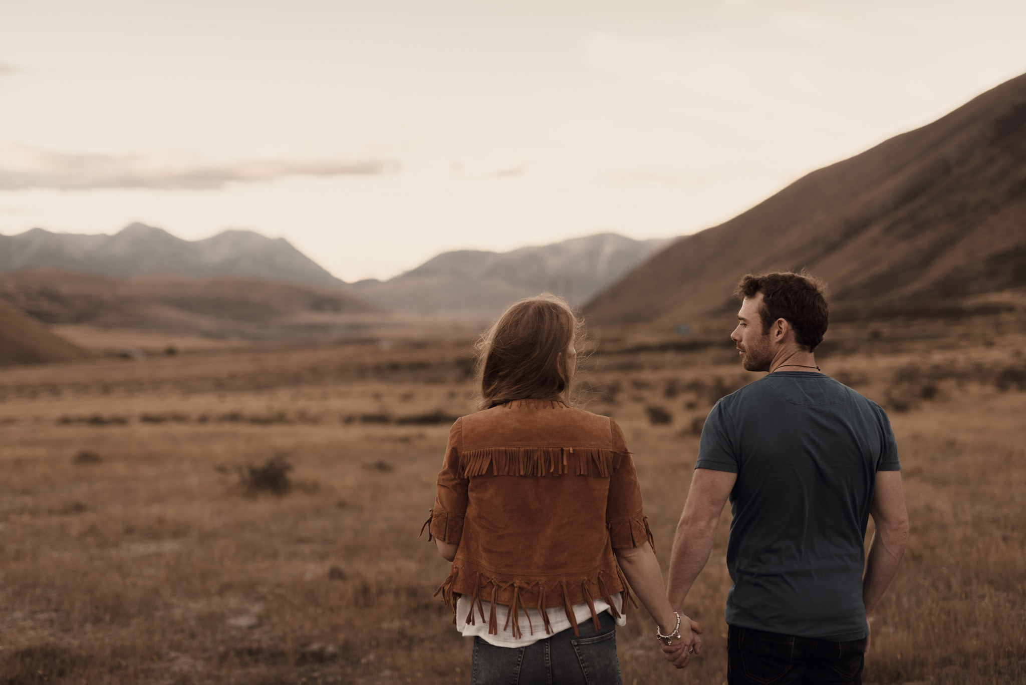 Couple in New Zealand looking at mountains