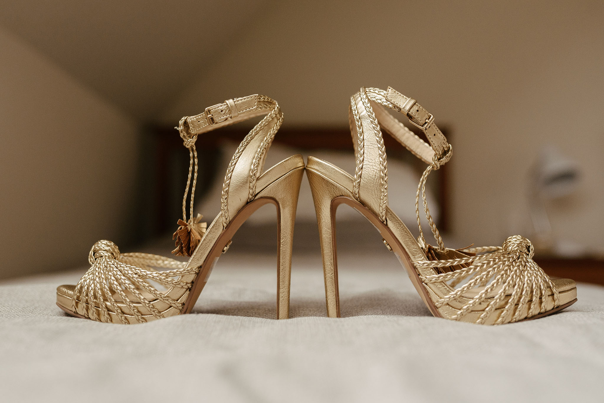 Golden wedding shoes for Quail Island, Christchurch wedding. Photos by Emma Brittenden.
