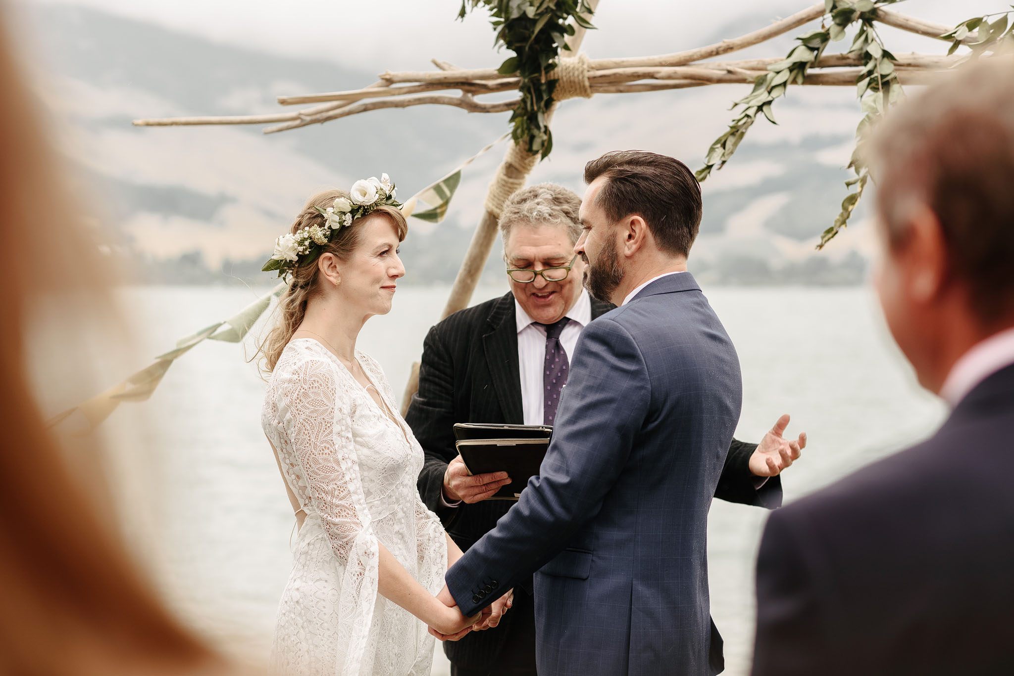 Photo of beach wedding in the rain on Quail Island in Lyttelton.