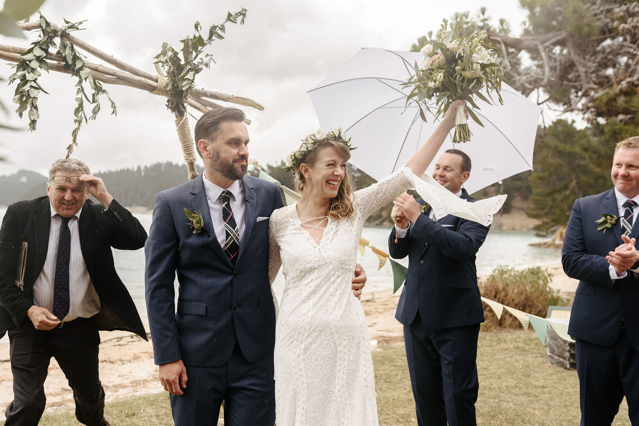 Happy rainy wedding in New Zealand by Emma Brittenden